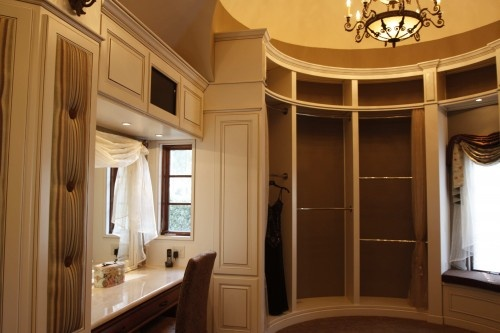 this dressing room has a lit vanity area with side windows, brilliant for natural light.  look at the molding & detail in here & check out that window seat!