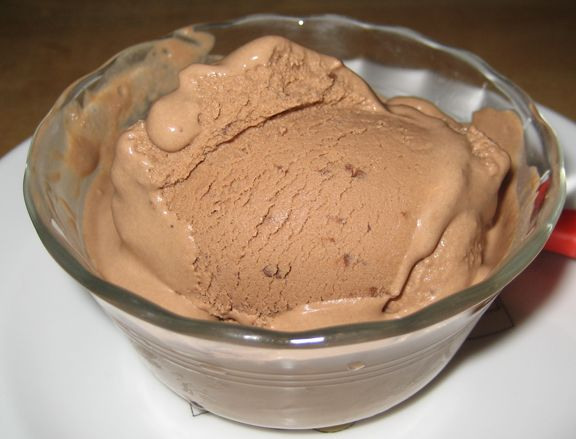 Chocolate Shakeology Ice Cream -   1 scoop Chocolate Shakeology  1 cup fresh strawberries  1-1/2 Tbsp. peanut butter (all-natural is best)  1 Philadelphia 1/3 Less Fat Neufchâtel Cheese Mini (1.25 oz.)  1/2 cup unsweetened almond milk (can use skim, coconut, or soy milk)  1/2 cup water  Ice (to taste)  Blend everything together, until mixed and creamy.  Place in the freezer and chill for 1hour or until set.  Enjoy!  Makes 1 serving. www.myshakeology.com/tbfn