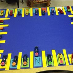 I made this during our transportation theme! A-Z parking lot. Perfect for letter recognition/uppercase & lowercase. My students still use it! :)