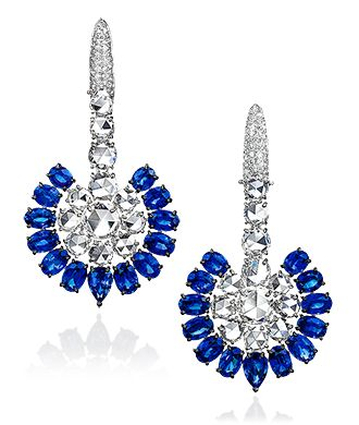 Cellini Jewelers breathtaking Sapphire and Diamond Earrings by Sutra jewelers. 8.52 carats of rose cut diamonds, are surrounded by 14.28 carats of sapphires in this beautiful pair. Set in 18 karat white gold.