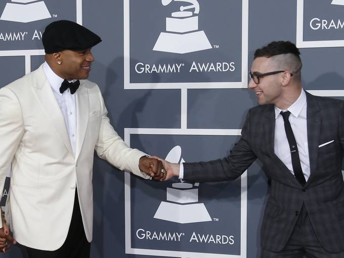 """Grammy host LL Cool J and Jack Antonoff, guitarist for Fun., arrive at the Grammys. Antonoff's band won best new artists and song of the year for """"We Are Young.""""  Dan MacMedan, USA TODAY"""