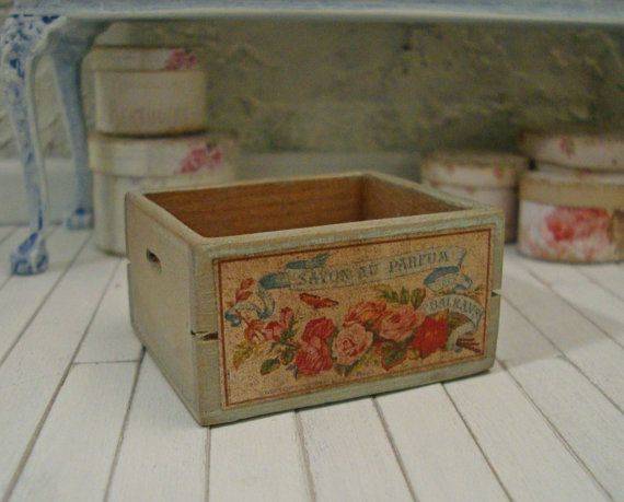 This engaging French flower crate is decorated with a lovely floral bouquet label boasting hues of pink, coral, corn flower blue and celadon. The