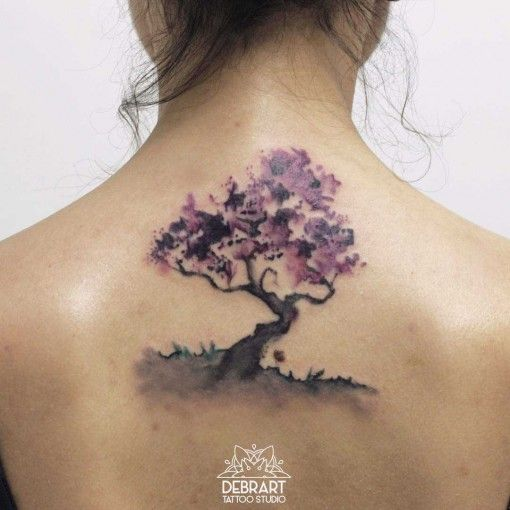 Tree tattoo on back watercolor tattoo style