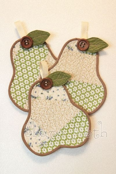 Green and pink coasters or potholders