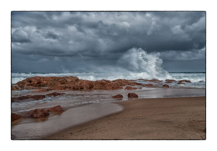 Breaking wave on the beach at Rocky Bay South Africa