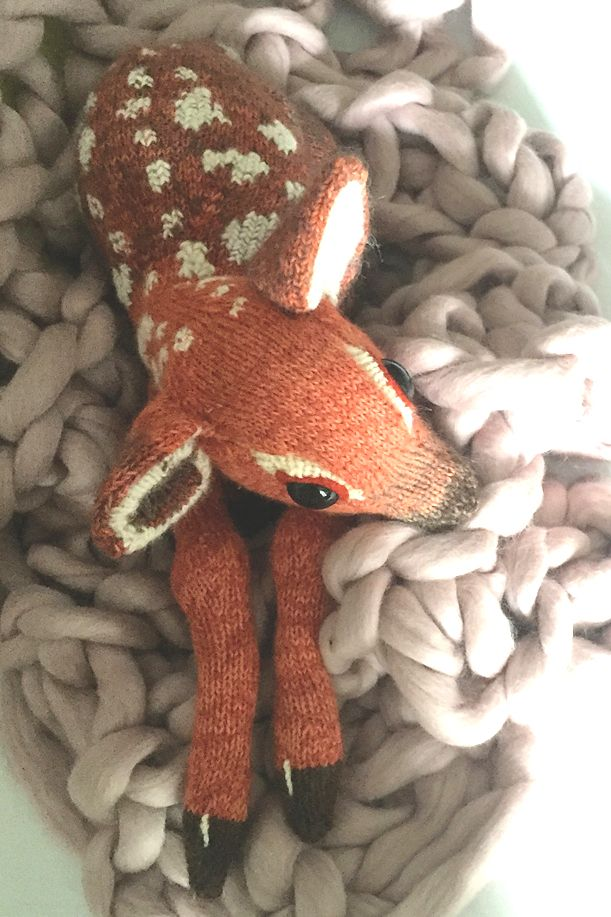 Knitting Pattern for Fawn – Baby deer softie is 38cm/ 15in long (top of ear to bottom of feet) and tall. Pattern comes with video tutorial. Designed by Claire Garland of Dot Pebbles Knits.