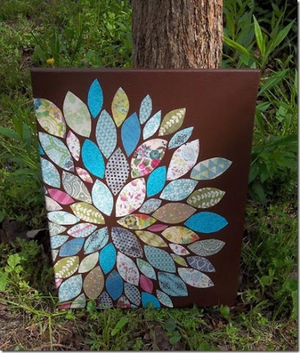 een canvas doek... met uitgeknipte blaadjes   modpodge
