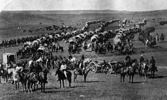 This is allegedly 110 Studebaker Covered Wagons circa 1874. Left of center is Lt. Col. George Armstrong Custer (light colored clothes). Sitting Bull's in there somewhere, too, but I haven't seen him yet. Rumor is this was a treaty violating expedition = Very. Bad. Custer. I've been wanting to pin all my Studebaker links for a long time. This pic said it was go time :)