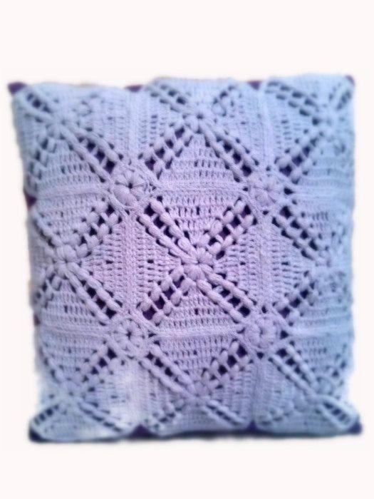 This pretty cute  fluffy round crochet pillow by SmallCrochetworld