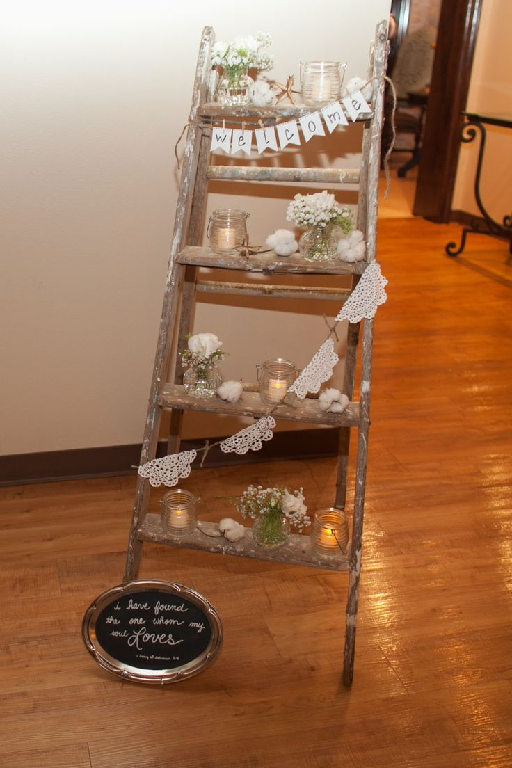 wedding welcome. vintage ladder candles, cotton, lace bunting