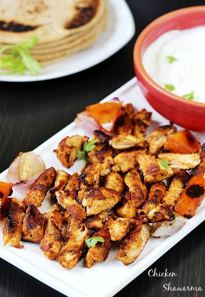 chicken shawarma recipe – shawarma or shawurma is a popular Arab dish that is prepared by grilling meat on a spit. It is prepared by stacking strips of marinated meat and fats alternately on a vertical spit, resulting in a large block of meat & fats. The block of meat is grilled slowly while the …