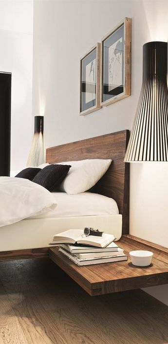 Applique murale 4230 noir h60cm de Secto Design, désignée par Seppo Koho. #applique #murale #secto #design #seppo #koho #noir #luminaire #design #interieur #chambre #indoor #lighting #room