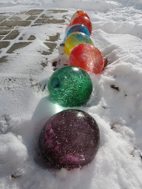 Fill balloons with water and add food coloring, once frozen cut the balloons off & they look like giant marbles.  I am doing this next winter.