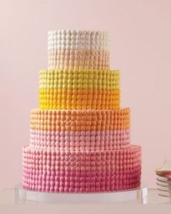 M & M Wedding Cake - four tiered round cake slathered in buttercream and layered with rows + rows of perfectly spaced M & M's