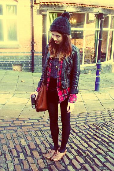 Red flannel under leather jacket, black leggings