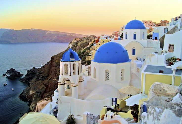 Santorini, Greece, white buildings, blue sea.