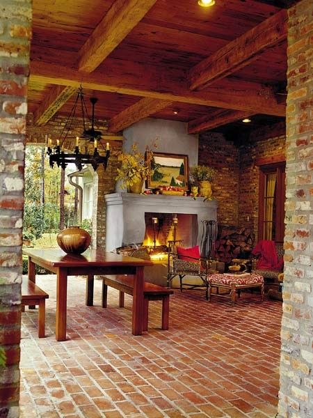 Outdoor living...many Tuscan elements to this space, the fireplace, chandelier and open beam ceiling
