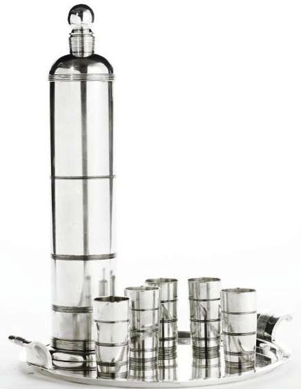 """Art Deco 1934 silver plated cocktail set made by International Silver Company. It was part of the """"International Giftware"""" series and sold as a set comprised of five cups, a shaker shaker and tray."""