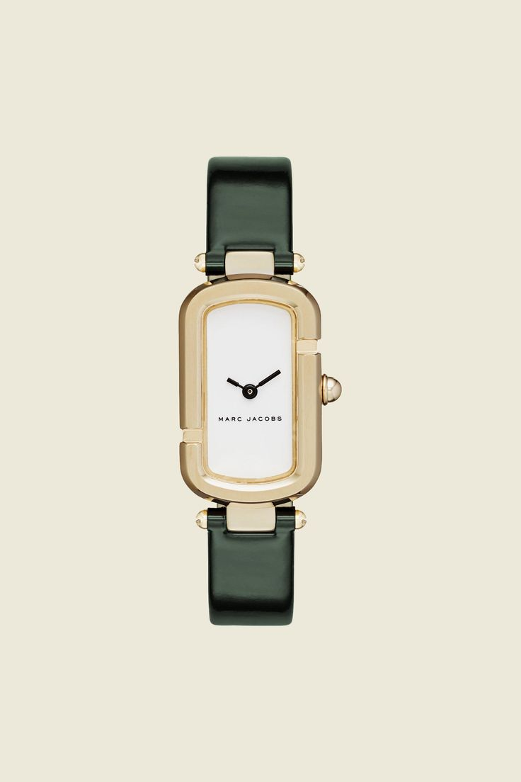 """The Jacobs Strap 31MM is distinctively different, with a gold-tone shaped case of the Marc Jacobs Monogram watch, made of two interlocking """"J""""s, highlighting the glossy white dial and dark green patent leather strap.//Quartz Analog//Water Resistant: 5 ATM//Two-Handed//Materials: 100% Stainless Steel, 100% Leather//CCO: Japan//"""