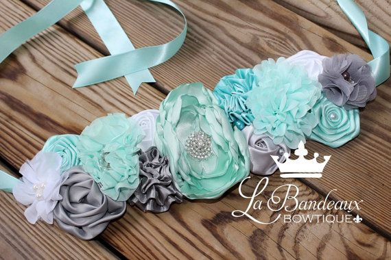 Say its a boy or a girl, with our beautiful aqua mint dream maternity sash. This piece features satin and chiffon rosettes, spirals, and