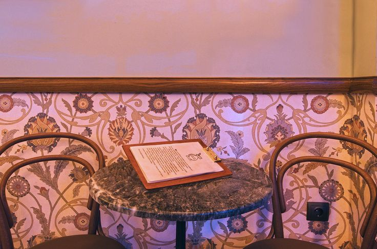floral wallpaper and wooden furniture | Retro bar Interior by AkPraxis. To see the whole project visit www.akpraxis.gr/... #old_pharmacy #bar #interior #design