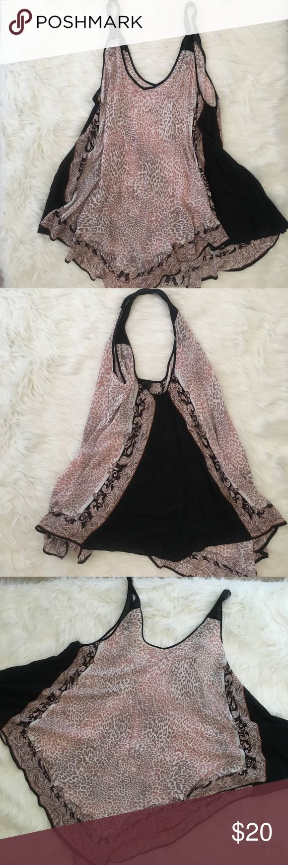 Free People Swinging Cheetah / Tribal Top / Dress Free People Swinging Cheetah / Tribal Top w/ Black side panels Size US M/L - super comfy with pair of legging on hot day. This can also be a dress for ladies that are shorter :) Free People Tops Blouses