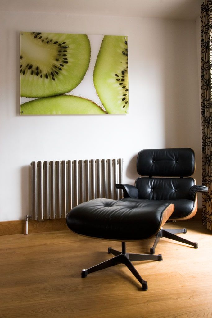 Modern townhouse interior - Eames chair and footstool