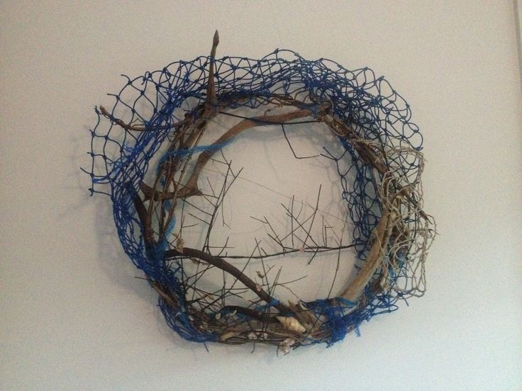 """Meet """" Sea Debris"""" - a piece created using debris collected off the beach- driftwood, sea fern, nylon fishing rope and fishing net and palm inflorescence."""