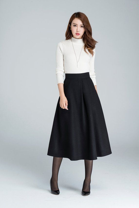 965c224a957a3 This midi wool skirt designed with black wool blend