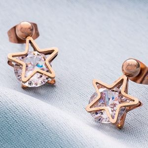Rose Gold Star Earrings With Crystal. Discover thoughtful, personal and wonderfully unique jewellery gifts for her this Christmas