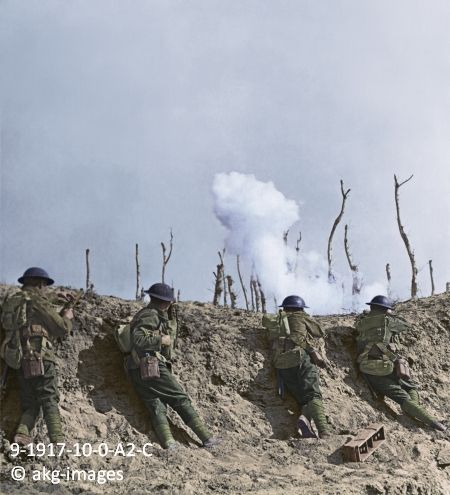 9-1917-10-0-A2-C British soldiers repulsing attacks by German troops, October 1917: In the firing line at Passchendaele, we repulse repeated...