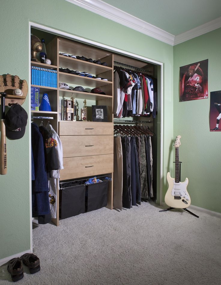 Boys Reach In Closet Shown With Modern Drawer Fronts In Candlelight