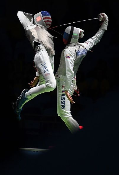 #RIO2016 US Gerek Meinhardt competes against Russia's Artur Akhmatkhuzin during the mens team foil semifinal bout between Russia and US as part of the fencing...