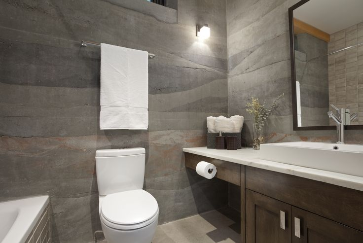 Master Bathroom - colours and hues of the rammed earth can be seen clearly.