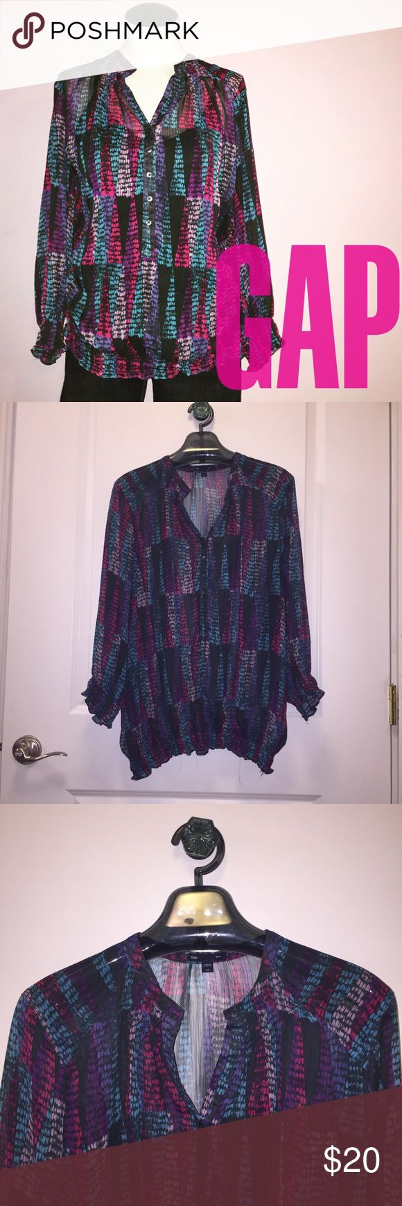GAP sheer colorful blouse 🔮 Like new! Gap sheer blouse patterned with elongated triangles in colors of magenta, purple, teal, light pink and black. Shown with a black cami underneath. Tunic style 1/2 Button-Down. Gathering at the neckline, cuffs and hem for a flowy look. Full-length sleeves. Perfect for spring/summer. Size XXL.  Bundles are only 2 items! Check out my closet, filter by your size, bundle up your likes and make an offer! GAP Tops Blouses