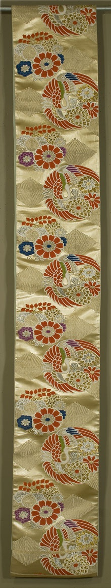 "Japanese Fukuro Obi  12""x 161""  Decorated section:  100½""  Gold lamé with gold, silver and silk  brocading"