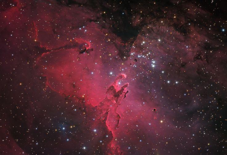 The Eagle Nebula. This beautifully detailed image of the region includes fantastic shapes made famous in well-known Hubble Space Telescope close-ups of the starforming complex. Described as elephant trunks or Pillars of Creation, dense, dusty columns rising near the center are light-years in length but are gravitationally contracting to form stars. Energetic radiation from the cluster stars erodes material near the tips, eventually exposing the embedded new stars.