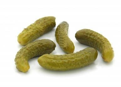 Cornichons are basically tiny French pickles. They are made from a European variety of cucumber called gherkins, which feature thin skins and tiny seeds and seed cavities, and are usually picked slightly immature, at only one to two inches long. the bulk cornichons were crisper and had a brighter, sharper flavor.