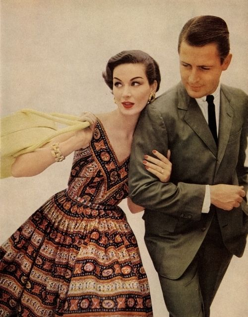 Model wearing batik patterned summer dress, 1950s. #batik
