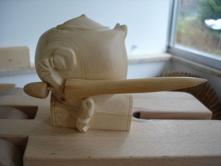 Woodcarving inspired by Pieter Bruegel The Elder's The Battle of the Money Bags and the Strong Boxes