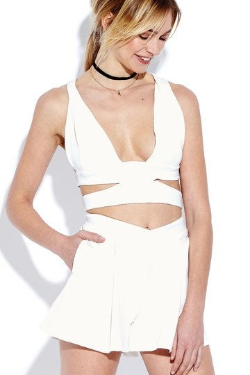 Ready, get set, go. This top is adorned with plunge v-neck, sleeveless, cut out details, cross strap back and crop silhouette. The shorts features zip back fastening. Pair them with heels.