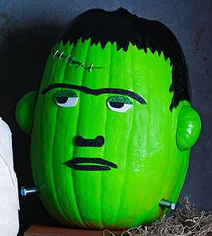 Frankenstein Pumpkin How-To ~ using small Gourds for the ears, 2 Bolts in the neck, and use a Stapler to staple over the line {scar} to create the look of stitches