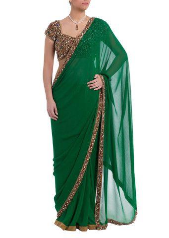 Seema Khan Enchanting emerald green saree with heavy jewelled, hand-work border. Contrasting multi-jewelled statement blouse included. #Saree #Jewledblouse #sareeblouse #Designer #Bollywoodfashion