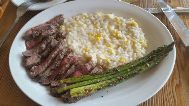 Pan seared Steak with Corn Risotto and Asparagus; Corn Risotto was a little bit off, almost cheapening it.