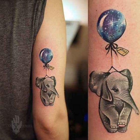 Lustiges farbiges Arm Tattoo mit traurigem Elefanten und Ballon