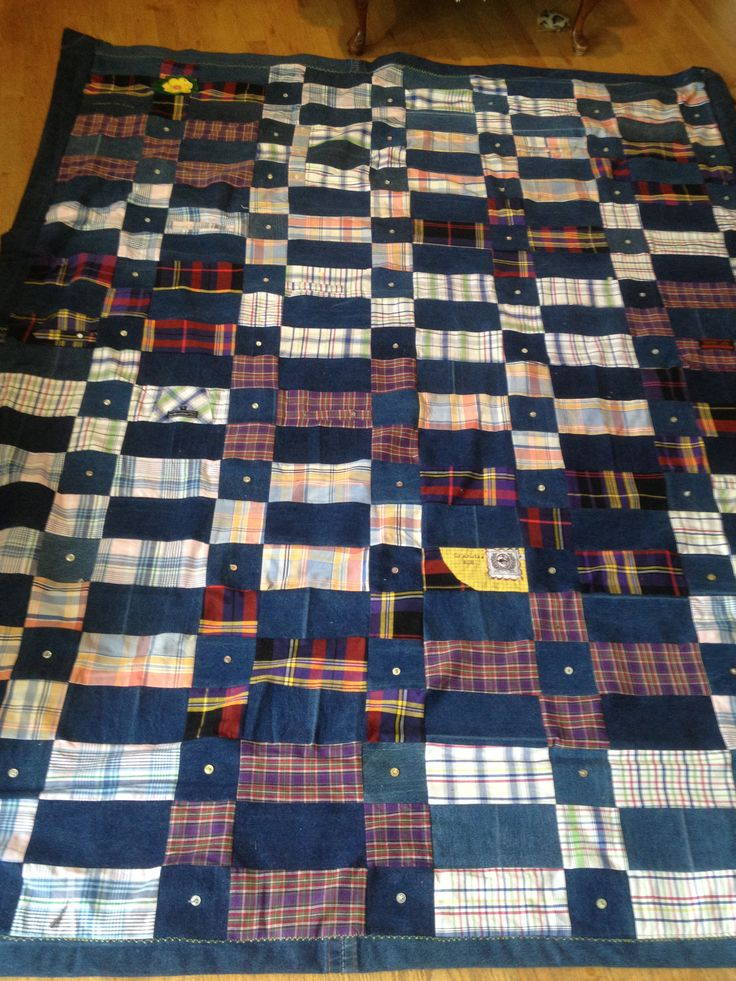 Quilt made out of Grandpa's wranglers and cowboy shirts and tied together with shirt buttons.