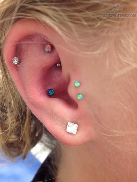 Lobe, Cartilage And Double Tragus Piercing With Color Barbell