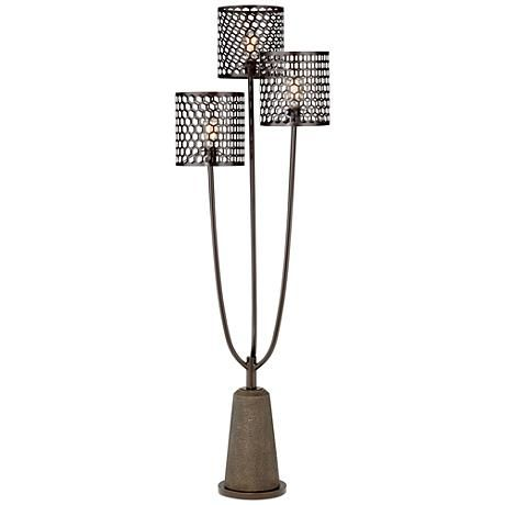 This three-light transitional floor lamp is shaded by metal mesh drum shades, and it sits atop a faux stone base.