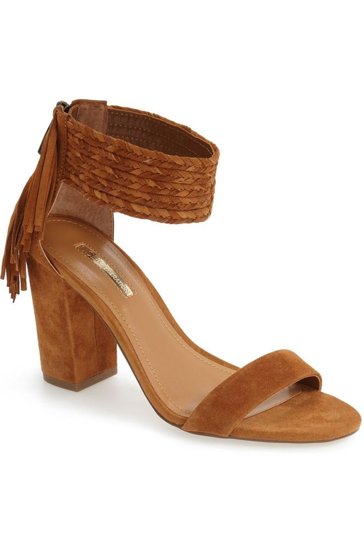 A chunky braided ankle strap and cascading fringe further the boho-chic appeal…