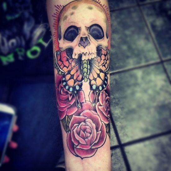 Awesome tattoo on the arm - skull, butterfly and 3 roses. tattoo